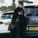 Rita Ora in Long Black Coat – Out in London - 454 x 654