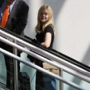 Elle Fanning – Arriving at LAX Airport in Los Angeles