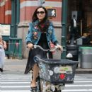 Famke Janssen – Riding a cargo bike in New York