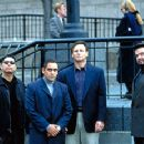 Charlie (Liam Neeson, second from right), an undercover DEA agent, does his noble best to maintain a facade of unflappable calm during nerve-jarring money laundering negotiations with psychotic mobsters (left to right) Estuvio (Michael DeLorenzo), Fidel V