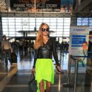 Paris Hilton is seen arriving at LAX August 26, 2016 - 450 x 600