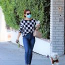 Lucy Hale – Out with her dog Elvis in Los Angeles