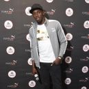 Usain Bolt Visits The PUMA Lab Powered By Foot Locker In NYC - 380 x 600