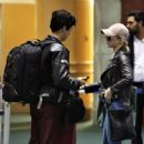 Lili Reinhart and Cole Sprouse- Arriving Back in Vancouver 01/10/2018 - 454 x 447