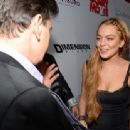 Actress Lindsay Lohan arrives at the Dimension Films' 'Scary Movie 5' premiere at the ArcLight Cinemas Cinerama Dome on April 11, 2013 in Hollywood, California