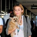 Miley Cyrus was spotted catching a departing flight out of the Los Angeles International Airport today, September 27