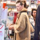 Milla Jovovich – Shopping at the Prada store in Beverly Hills - 454 x 634
