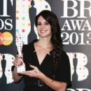 Lana Del Rey poses with the International Female Solo Artist award in the press room at the Brit Awards 2013 at the 02 Arena on February 20, 2013 in London, England
