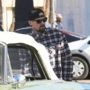 Benji Madden stops to re-fuel his classic car while out and about in Los Angeles, California on December 30, 2013