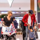 Amber Rose and Wiz Khalifa Shopping with Their Son Sebastian at Topanga Mall in Los Angeles, California - December 23, 2015