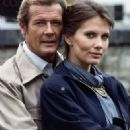 Roger Moore and Maud Adams - 323 x 480