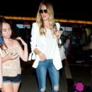 Model Rosie Huntington-Whiteley arriving on a flight at LAX in Los Angeles, California on August 22, 2014