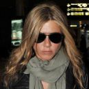 Jennifer Aniston - Arrives At Charles De Gaulle Airport In Paris, France - March 25, 2010