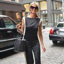 Heidi Klum is all smiles as she runs errands in New York City on July 23, 2013