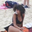 Imaan Hammam in Black Bikini at Ipanema Beach in Rio de Janeiro