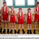 Greg (Zachary Gordon, third from right) and Rowley (Robert Capron), stand out (or down) from the rest of the singlet-clad wrestling team. Photo credit: Rob McEwan - 454 x 348