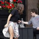 Careful not to flash! Jenna Coleman is caught in a breeze on daytime date with Richard Madden