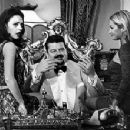 Robbie Coltrane sits in his casino lair in MGM's The World Is Not Enough - 11/99