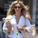 Ashley Tisdale and her dog Maui were spotted leaving the nail salon today, June 12, in Los Angeles