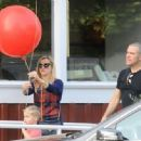 Reese Witherspoon at the Brentwood Country Market with her hubby and their son Tennessee in Brent wood, California on December 10, 2016 - 454 x 334