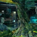 Jake (Sam Worthington, left) and Quaritch (Stephen Lang) get a virtual look a massive, gnarled and ancient willow tree that is the Na'vi epicenter and an extension of their lifeblood. Photo credit: WETA