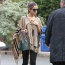 Selena Gomez spotted without makeup heading to a friend's house on a rainy day in Los Angeles, California on December 19, 2013