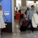 Still in white! Sofia Wellesley looks radiant in lace dress as she arrives at Majorca airport with James Blunt... following their lavish wedding ceremony