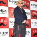"Johnny Depp attends the photo call for ""Mortdecai"" at The Peninsula Tokyo on January 28, 2015 in Tokyo, Japan"
