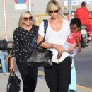 Charlize Theron- at a Cretan airport with her kids August 2016 - 454 x 635