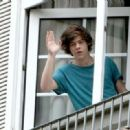 The boys of One Direction were spotted waving to fans from the balcony of their hotel, June 6, in Mexico City