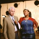 Peter Sanderson (Steve Martin, left) finds his perfectly ordered life turned upside down when Charlene (Queen Latifah, center) comes into his world