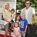Tori Spelling and her family attending at various events through the years - 454 x 587