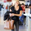 Malin Akerman departing on a flight at LAX airport in Los Angeles, California on January 26, 2015 - 371 x 600