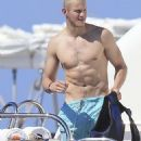 Nina Dobrev and Alexander Ludwig show off their amazing beach-ready bodies while hanging out on a yacht on Friday (August 22) in Ibiza, Spain