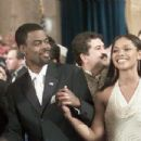 Presidential candidate Mays Gilliam (Chris Rock) rocks the vote with Lisa Clark (Tamala Jones) at his side