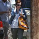 Couple Alyson Hannigan and Alexis Denisof spend some time together at a park in Brentwood, California on July 17, 2015 - 405 x 600