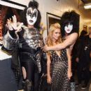 Paris Hilton poses with musicians Gene Simmons and Paul Stanley of KISS backstage at Fashion Rocks 2014 presented by Three Lions Entertainment at the Barclays Center of Brooklyn on September 9, 2014 in New York City