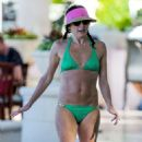 Andrea Corr in Green Bikini on the beach in Barbados - 454 x 541