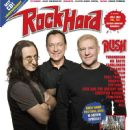 Alex Lifeson, Geddy Lee, Neil Peart - Rock Hard Magazine Cover [Germany] (July 2012)