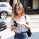 Actress and singer Lucy Hale stops by Starbucks in Los Angeles, California to pick up an iced coffee on August 24, 2016 - 439 x 600