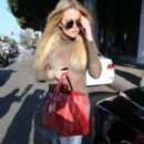 Khloe Kardashian is seen leaving the Meche Hair Salon after getting her hair done in Beverly Hills, California on May 9, 2016