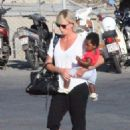 Charlize Theron- at a Cretan airport with her kids August 2016 - 454 x 631