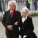 Brian May and Anita Dobson attend a service of thanksgiving for Lady Soames at Westminster Abbey on November 20, 2014 in London, England. - 434 x 594