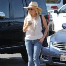 Reese Witherspoon stops by a grocery store for a few items including a couple of coffees from a Starbucks inside the store in Brentwood, California on September 8, 2015