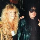 Mick Mars and Emi Canyn