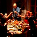 Patriarch Martin (Hector Elizondo) makes an announcement to his dinner guests (counter-clockwise from left) April (Marisabel Garcia), Yolanda (Constance Marie), Andy (Nikolai Kinski), Maribel (Tamara Mello), Carmen (Jacqueline Obradors), Leticia (Elizabet - 400 x 250