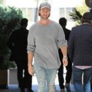 Patrick Schwarzenegger is spotted grabbing lunch with his Dad at Cafe Roma in Beverly Hills, California on March 28, 2017