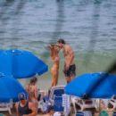 Nina Dobrev – Wearing pink bikini at a beach in Maui