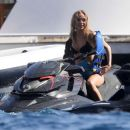 Kimberley Garner in Black Bikini on a yacht in Italy - 454 x 387