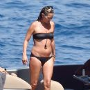 Kate Moss on a boat with friends in Portofino